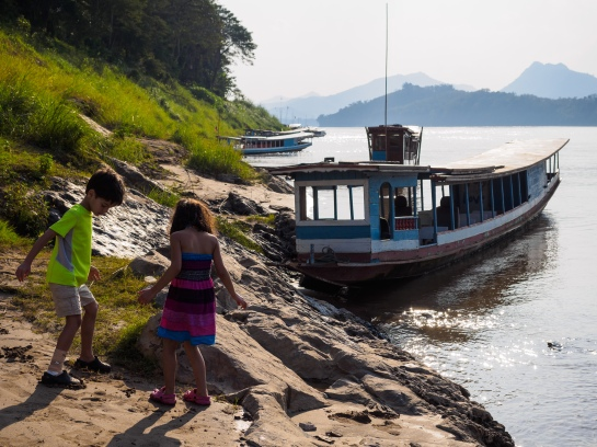 My kids playing along the Mekong River